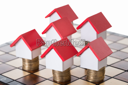 house models and stacked coins on