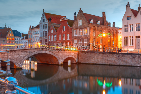 night bruges canal and bridge belgium