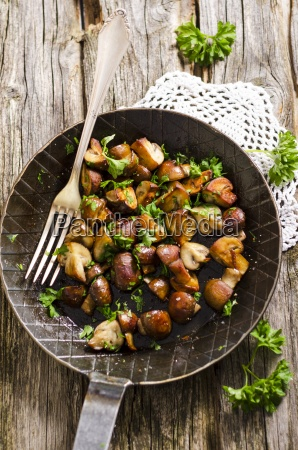 frying pan with fried champignons