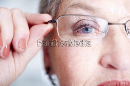 close up of senior woman wearing