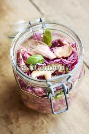 preserving jar of red cabbage salad