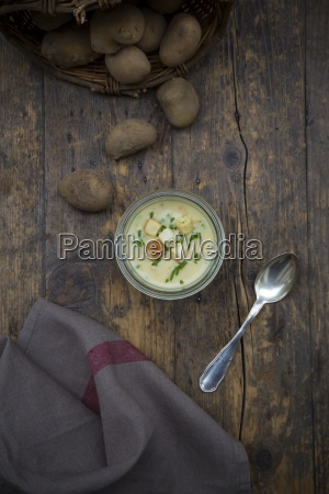 glass of potato soup garnished with