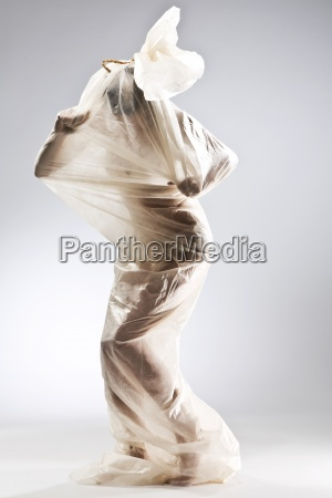 naked woman wrapped in foil