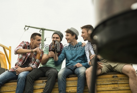 group of friends drinking beer on