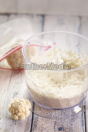 minced cauliflower in mixer bowl