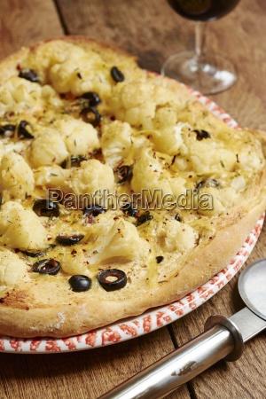 homemade vegan cauliflower olive pizza
