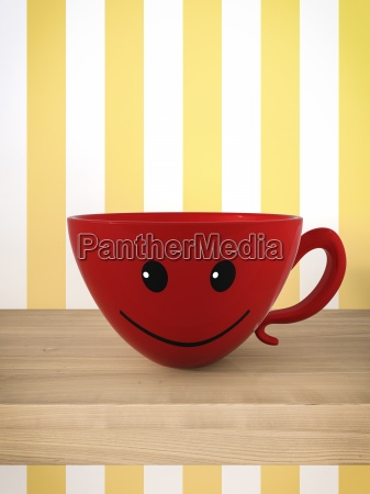 smiling red cup on a shelf