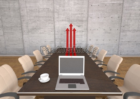 meeting room with table chairs laptop