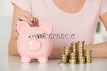 close up of woman inserting coin