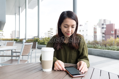 woman use of cellphone in coffee