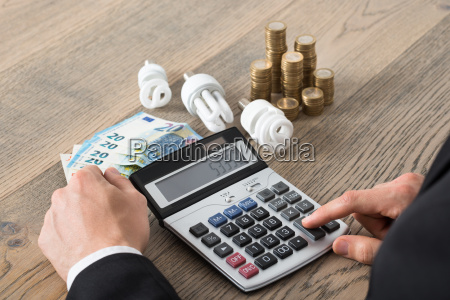 businessman calculating energy costs