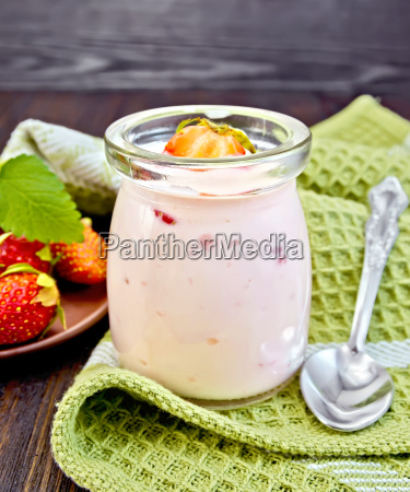 yogurt with strawberries in jar on