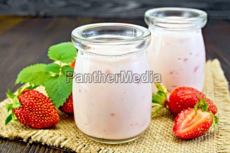 yogurt with strawberries on sacking