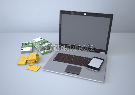laptop with smartphone gold bars and