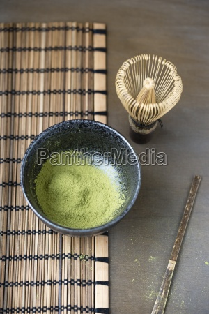 bowl of matcha matcha whisk spatula