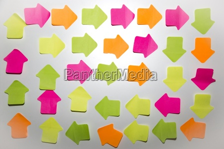 coloured arrow shaped adhesive notes on