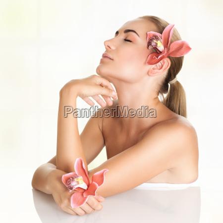 pretty girl enjoying day spa