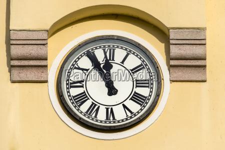 austria church clock shwing five to