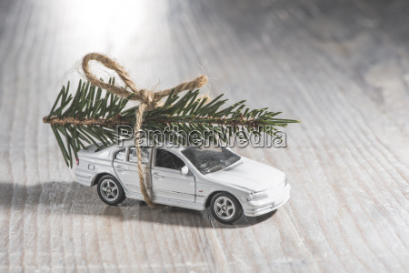 white car toy with christmas tree