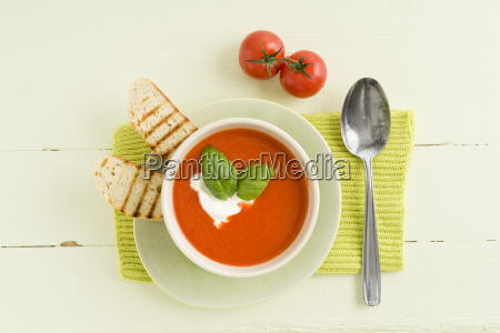 tomato cream soup with baguette slice