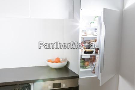 modern kitchen open fridge and light