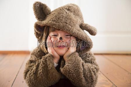 portrait of happy little girl masquerade