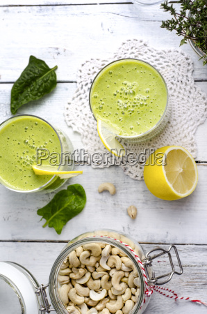 two glasses of spinach smoothie cashew