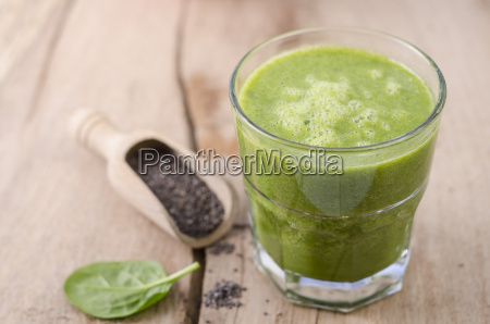 glass of spinach smoothie chia seeds