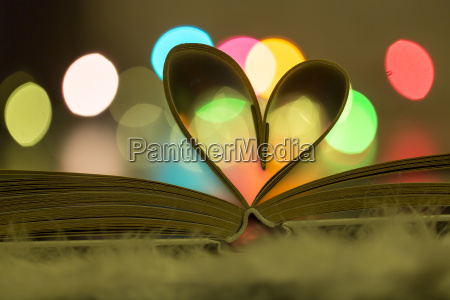heart shaped book pages in front
