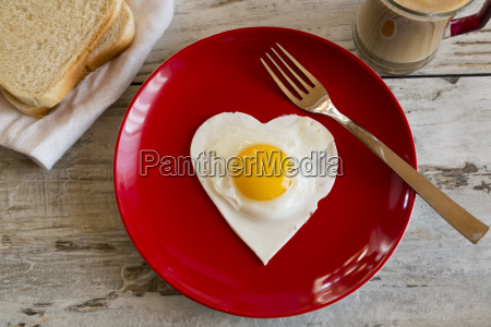 heart shaped fried egg on red