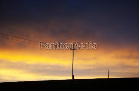 austria power line against sunset sky