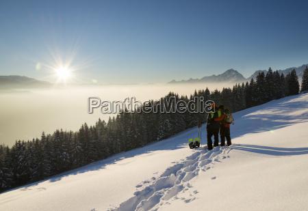 austria tyrol schwaz couple with snowshoes