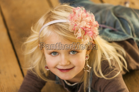 portrait of smiling blond little girl