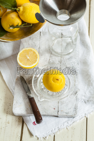 fresh lemons in squeezer for