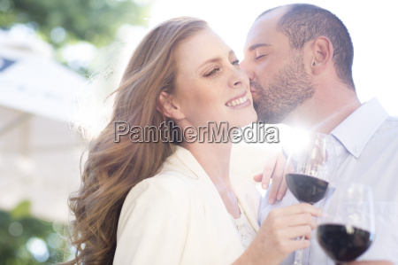happy couple holding wine glasses and