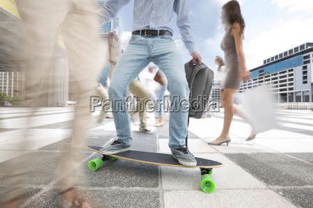 city commuter on a skateboard between