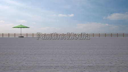 green sunshade on wooden terrace in