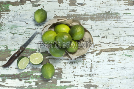 whole and sliced limes and kitchen