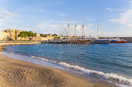 greece rhodes harbor city wall and