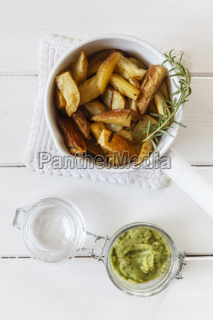 casserolle of potato wedges with rosemary