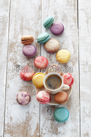 cup of coffee and macarons on