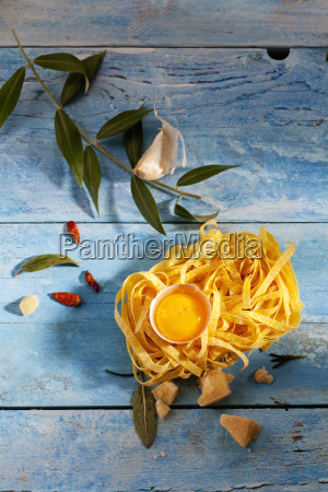 raw tagliatelle egg yolk in eggshell