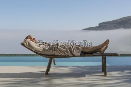 man in bathrobe lying on a