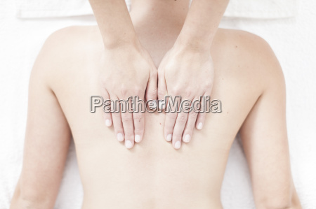 young woman giving a back massage