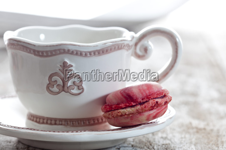 coffee cup with raspberry macaron