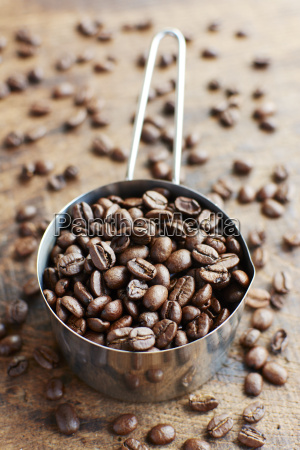 measuring cup of coffee beans
