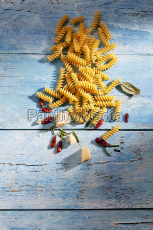 uncooked fusilli chili pods sage leaves