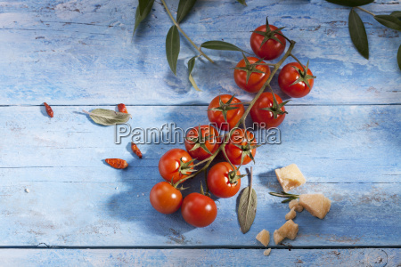 cherry tomatoes chili pods sage leaves