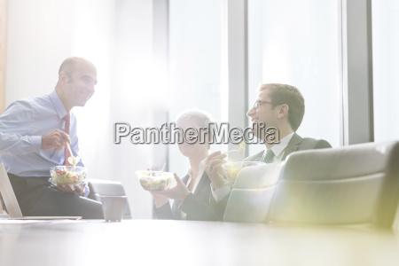 business people having lunch break in