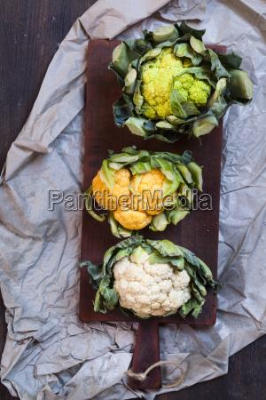 cauliflowers green orange and white on